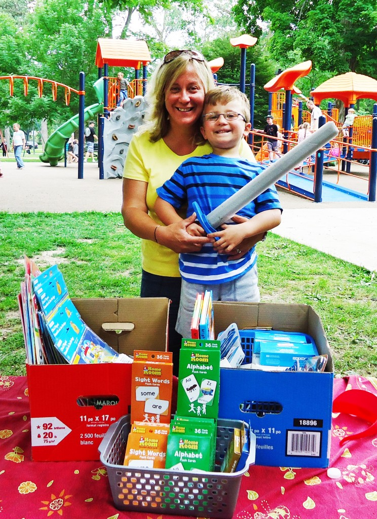Carolyn Gec and her son donate school suppplies for CHW