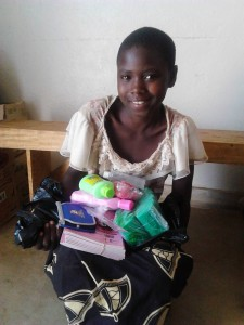 Girls receiving provisions for school