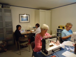 Volunteers sewing sanitary protection